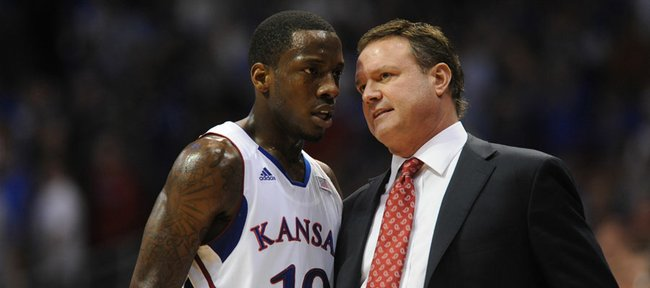 Kansas guard Tyshawn Taylor and KU coach Bill Self have some words during the first half of Monday's game against Baylor.