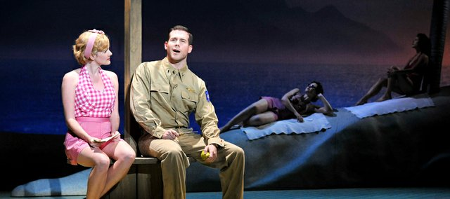 """Katie Reid, as Ensign Nellie Forbush, and Shane Donovan, as Lt. Joe Cable, perform in """"South Pacific."""" The Lied Center hosts a performance Wednesday, Jan. 18, at 7:30 p.m. There is a pre-performance lecture on the importance of the musical."""