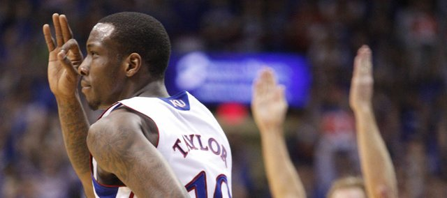 "Kansas guard Tyshawn Taylor signals ""three"" after a bucket against Baylor during the first half on Monday, Jan. 16, 2012 at Allen Fieldhouse."