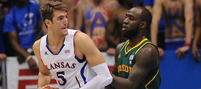 Kansas University center Jeff Withey (5) muscles his way past Baylor's Qunicy Acy, right, on Monday in Allen Fieldhouse.