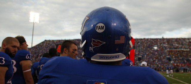 A sticker worn on the back of each player's helmet pays tribute to former Kansas coach, player and longtime supporter Don Fambrough in this file photo from September. Fambrough — a noted hater of all things Missouri — died in September.