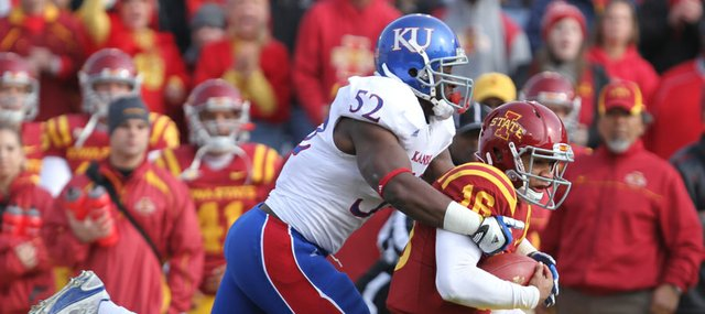 Kansas linebacker Steven Johnson catches up with Iowa State quarterback Jared Barnett after a long run in the second quarter on Saturday, Nov. 5, 2011 at Jack Trice Stadium in Ames, Iowa.