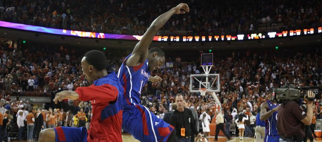 Kansas guard Tyshawn Taylor, right, gets a bump from teammate Naadir Tharpe after the Jayhawks&#39; 69-66 win over Texas on Saturday, Jan. 21, 2012 at the Frank Erwin Center.