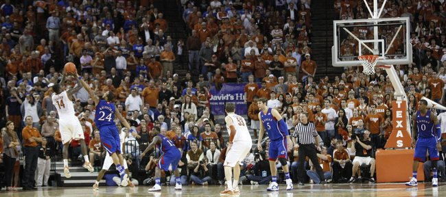 Kansas guard Travis Releford gets a hand on a three to block a shot by Texas guard J'Covan Brown late in the second half on Saturday, Jan. 21, 2012 at the Frank Erwin Center.