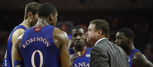 Kansas head coach Bill Self huddles with his team late in the second half on Saturday, Jan. 21, 2012 at the Frank Erwin Center.