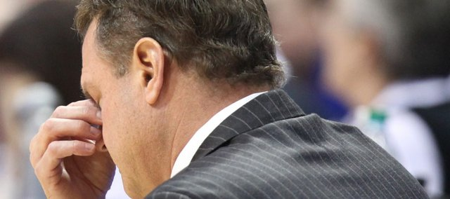 Kansas head coach Bill Self puts his head in his hand after a foul by the Jayhawks during the second half on Monday, Jan. 23, 2012 at Allen Fieldhouse.