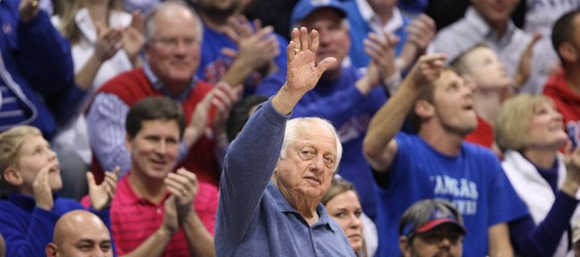 Longtime Dodgers coach Tommy Lasorda waves to the fieldhouse crowd as he is introduced during the second half on Monday, Jan. 23, 2012.