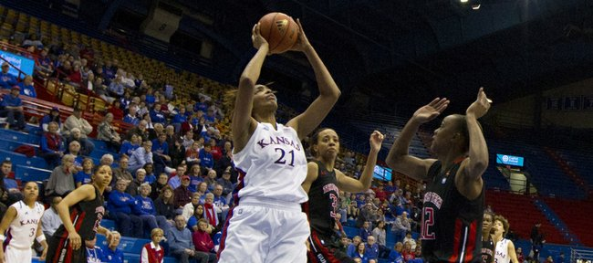 Kansas forward Carolyn Davis (21) turns to shoot during Kansas' game against Texas Tech on Wednesday, Jan