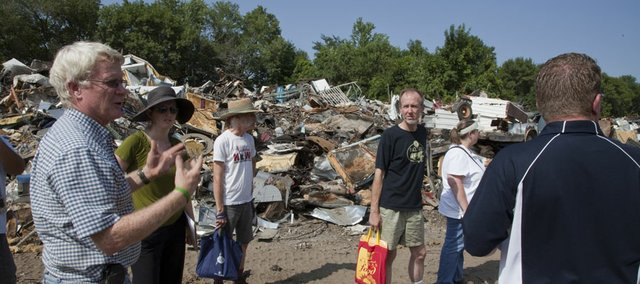 Representatives of 12th and Haskell Recycling Center, including owner Bo Killough, left, met with residents of the Brook Creek Neighborhood on Wednesday to discuss changes in operations on the property in this Aug. 2010 file photo.