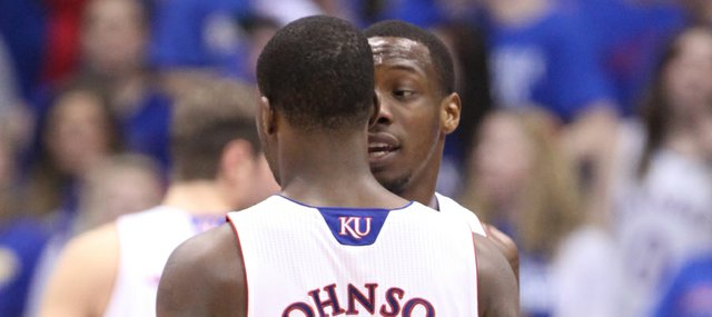 Kansas guard Tyshawn Taylor gives a pep talk to teammate Elijah Johnson during the second half on Monday, Jan. 23, 2012 at Allen Fieldhouse.