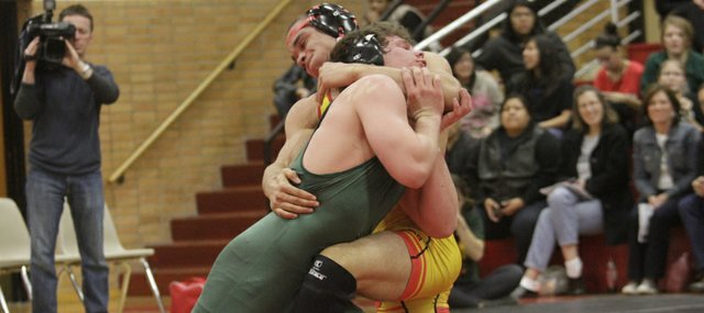In a battle of top-rated, 182-pound wrestlers, Lawrence Free State's Spencer Wilson, left, and Lawrence High's Reece Wright-Conklin struggle for position during LHS's meet on Wednesday, Jan 25, 2012. Wright-Conklin won on points, and the Lions also won the meet.