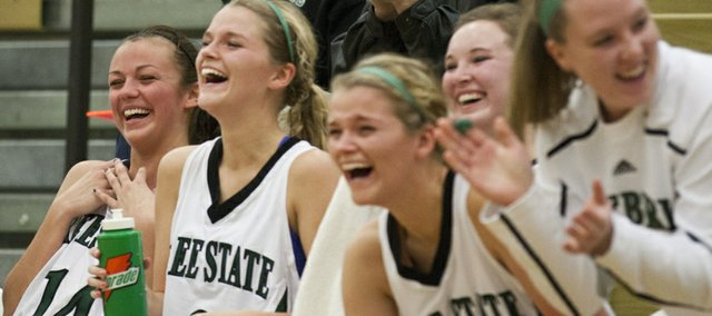 Free State senior Lynn Robinson, left, and other players on the bench laugh on the sideline during the closing minute of Free State's opening-round game against Blue Valley West in the Firebird Winter Classic held Thursday, Jan. 26, 2012 at FSHS.