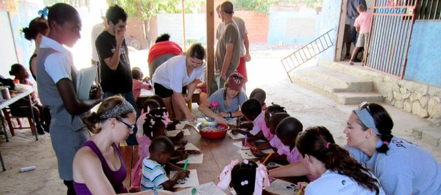 Baker students interact with the kindergarten class offered at Ecole Shalom, the school located on the Haitian-American Caucus's compound we stayed on in Croix des Bouquets, a village outside of Port-au-Prince.