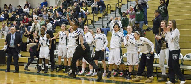 The Free State bench erupts after Kennedy Kirkpatrick hit the game-winning shot during Free State's semifinal game against Washburn Rural in the Firebird Winter Classic Friday, Jan. 27, 2012 at FSHS.