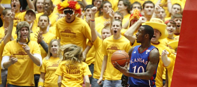 "Kansas guard Tyshawn Taylor glances over as the Iowa State student section, ""Cyclone Alley,"" goes wild following an ISU three-pointer during the first half on Wednesday, Jan. 12, 2011 at Hilton Coliseum in Ames, Iowa. Despite the hostile environment, the Jayhawks held on to win, 84-79."