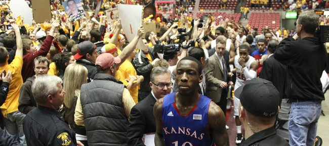 Kansas guard Tyshawn Taylor makes his way through the chaos on the court after Iowa State's 72-64 upset of the Jayhawks on Saturday, Jan. 28, 2012 at Hilton Coliseum.