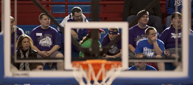 Campers sit in the bleachers as they wait for the Kansas men's basketball team to arrive before the 28th annual Wilt Chamberlain Basketball Clinic held Sunday, Jan. 29, 2012, in Allen Fieldhouse.