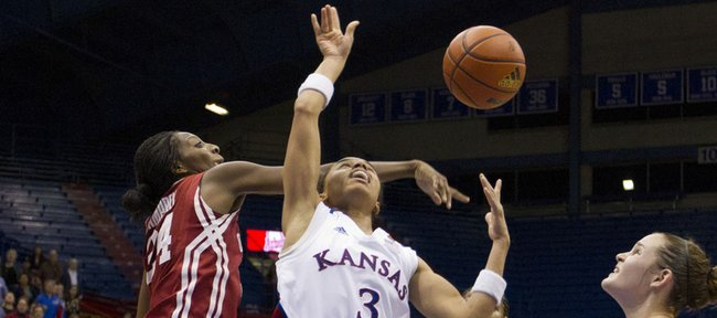 Kansas guard Angel Goodrich (3) has her shot rejected by Oklahoma forward Jacqueline Jeffcoat during Kansas' game against Oklahoma Tuesday, Jan 31, 2012, at Allen Fieldhouse.