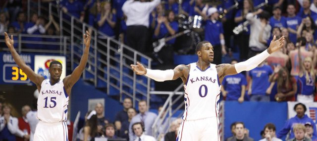 Kansas players Thomas Robinson (0) and Elijah Johnson (15) raise up the fieldhouse during a run by the Jayhawks in the second half on Wednesday, February 1, 2012 at Allen Fieldhouse.