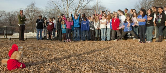 Broken Arrow fourth-graders watch, and some celebrate, as Alvin the Chipmunk casts a long shadow in the morning sun on Groundhog Day, Thursday, Feb. 2, 2012. Teacher Ginny Turvey, out of frame at left, has made a class activity out of using the stuffed Alvin as a substitute groundhog for the annual tradition.