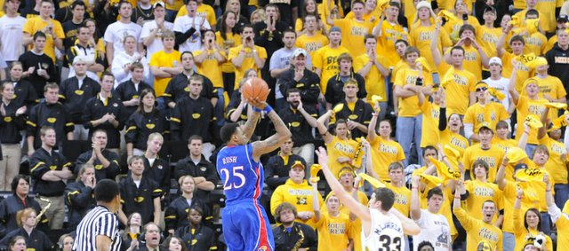 Former Kansas guard Brandon Rush elevates for a jumper over Missouri forward Matt Lawrence in this Jan. 19, 2008, file photo in Columbia, Mo. The Mizzou student section should be out in full force for tonight's KU-MU game in Columbia, Mo. The Tigers are 14-0 at home this season.