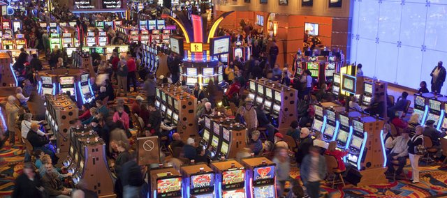 Crowds fill the floor of the new Hollywood Casino, a Las Vegas-style casino at the Kansas Speedway, Friday, Feb. 3, 2012. The casino is the first one in the Kansas City market in 15 years.