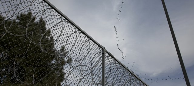 Razor wire is wrapped near the top of twelve-foot fencing at the Lansing Correctional Facility East Unit. Last year, none of the 39 people seeking pardons from Gov. Sam Brownback received them, an open records request by the Journal-World has revealed.