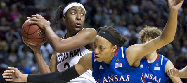 Texas A&M's Kelsey Bone grabs a rebound against Kansas' Aishah Sutherland (11) during the first half. A&M beat KU, 62-51, Saturday in College Station, Texas.