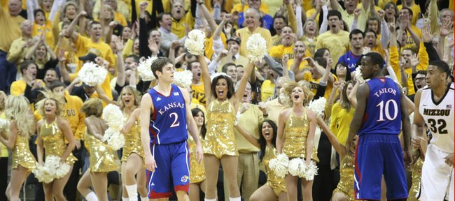 The Missouri dance squad and fans erupt before Kansas players Conner Teahan and Tyshawn Taylor after a three pointer by Missouri guard Marcus Denmon put the Tigers up by one late in the second half on Saturday, Feb. 4, 2012 at Mizzou Arena.
