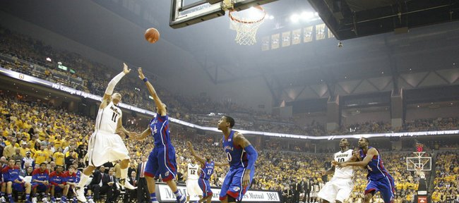 Missouri guard Michael Dixon puts up a shot over Kansas guard Travis Releford during the first half on Saturday, Feb. 4, 2012 at Mizzou Arena.