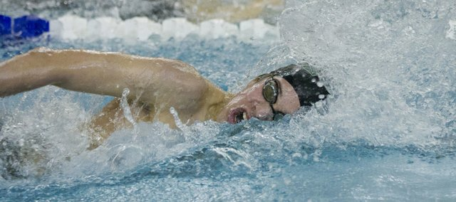 Free State's Canaan Campbell competes in the 500 yard freestyle event at the Boy's Sunflower League Championships Saturday, Feb. 4, 2012 in Olathe.