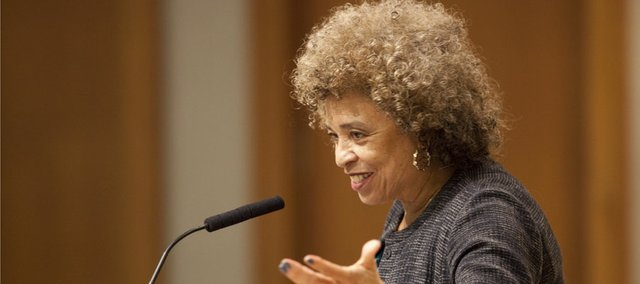 "Activist Angela Davis speaks to those gathered for her lecture, ""Feminism and Activism,"" Tuesday at Budig Hall on the Kansas University campus. Davis touched on her personal history of activism, her stance as a prison abolitionist, what she sees as present-day threats to reproductive rights and ""both how far we have come and how far we have not come"" as a culture and nation on issues of women's rights."