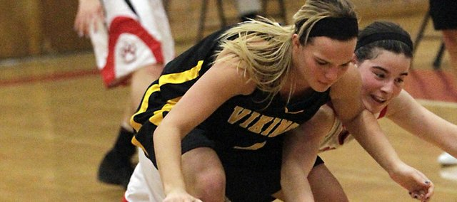 Lawrence High's Anna Wright, right, tries for a steal from SM West's Whitney Crow on Monday February 6, 2012.
