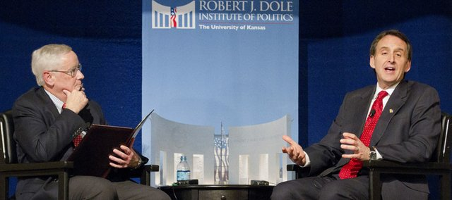 Dole Institute director Bill Lacy, left, listens as former Republican presidential candidate Tim Pawlenty speaks Tuesday, Feb. 7, 2012 at the Dole Institute of Politics.