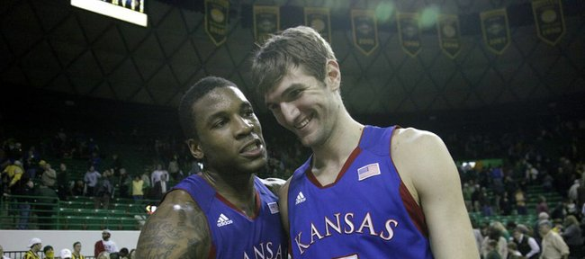 Thomas Robinson (0) left congratulates Jeff Withey (5) at the end of the Jayhawks 68-54 win over the Baylor Bears, Wednesday, Feb. 8, 2012 at Baylor. Withey had a career high 25 points in the win.