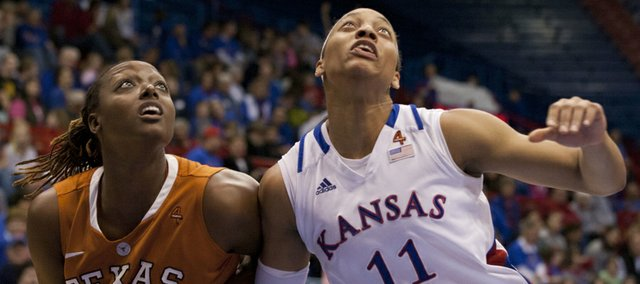 Kansas forward Aishah Sutherland (11) and Texas' Ashley Gayle (22) struggle for rebounding position during Kansas' game against Texas on Wednesday, Feb. 8, 2012, at Allen Fieldhouse.
