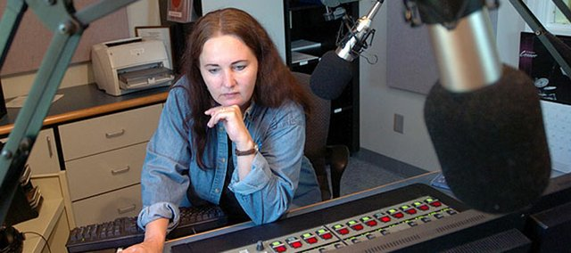 Cordelia Brown, operations manager at KANU, 91.5 FM radio, works her classical music programming shift at the Lawrence Kansas Public Radio studio in this 2005 file photo. A divided House Appropriations Committee on Thursday rejected $800,000 sought by public broadcasting.