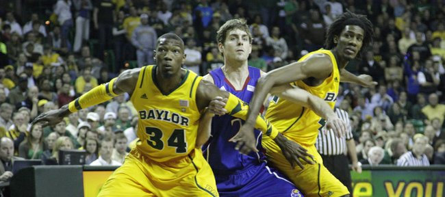Connor Teahan (2) gets blocked by Baylor's Cory Jefferson (34) and Anthony Jones (41) in the first half of the Jayhawks' game against the Bears.