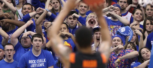 The Kansas student section tries to disrupt a free throw from Oklahoma State forward Le'Bryan Nash during the second half on Saturday, Feb. 11, 2012 at Allen Fieldhouse.
