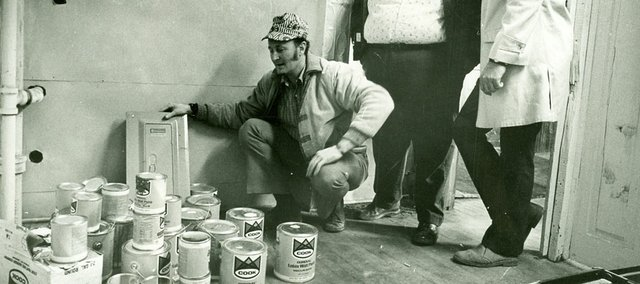 Bob Wells, former president of the Lawrence Jaycees, from left, Bob Lee, Jaycees internal vice president, and Jon Weekly, president of the Lawrence Lions Club, look over supplies in this Jan. 19, 1973, file photo, to be used for remodeling rooms at 945 Mass. for the Boys Club of Lawrence.