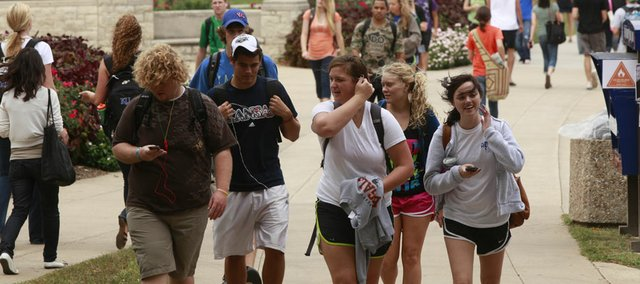 In this 2010 file photo, students walk on Kansas University's campus. Universities in Kansas are now taking measures to make it easier to transfer from a community college.