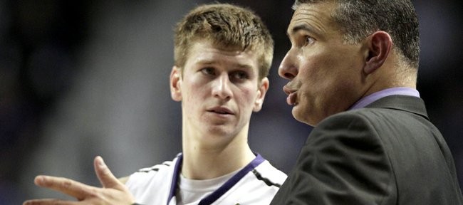 Kansas State coach Frank Martin, right, talks to guard Will Spradling during the second half of an NCAA college basketball game against Oklahoma, Saturday, Jan. 28, 2012, in Manhattan, Kan. Oklahoma won the game 63-60.