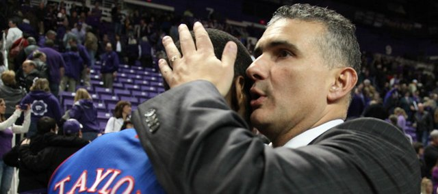 Kansas State head coach Frank Martin gives a hug and encouraging words to Kansas guard Tyshawn Taylor after the Jayhawks' 59-53 win on Monday, Feb. 13, 2012 at Bramlage Coliseum.