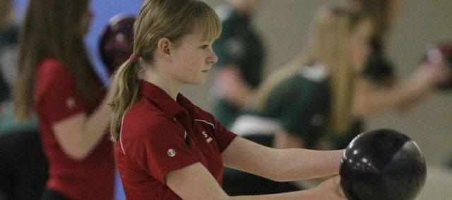 Lawrence High's Rebecca McNemee approaches the lane during the crosstown bowling matchup between LHS and Free State on Tuesday, Feb. 14, 2012, at Royal Crest Lanes.