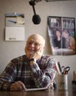 Chuck Fisher, a 38-year Audio Reader volunteer, is pictured on Feb. 6 inside a studio. Fisher, who grew up in Lawrence, says he used to read to his grandfather on weekends when he was in high school. I guess Im still reading for him in some way, Fisher said.