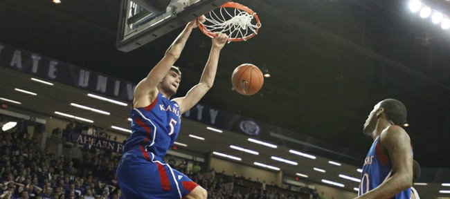 Kansas center Jeff Withey dunks off an alley-oop from teammate Tyshawn Taylor against Kansas State during the first half on Monday, Feb. 13, 2012 at Bramlage Coliseum.