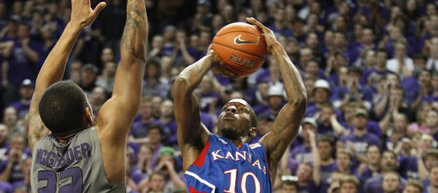 Kansas guard Tyshawn Taylor pulls up for a jumper over Kansas State defenders Rodney McGruder and Angel Rodriguez during the second half on Monday, Feb. 13, 2012 at Bramlage Coliseum.