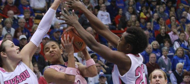 Kansas guard Angel Goodrich goes up for a shot between Missouri defenders Christine Flores, left, and BreAnna Brock. Missouri picked up its first Big 12 victory with a 70-65 win over KU on Saturday afternoon at Allen Fieldhouse.