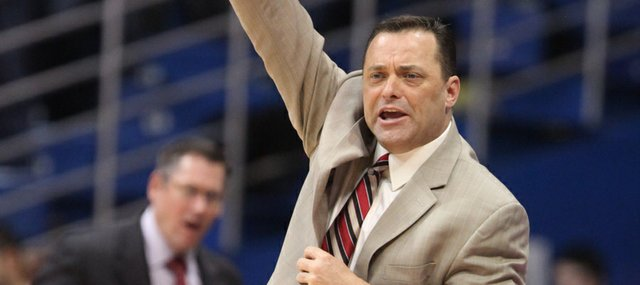 Texas Tech head coach Billy Gillispie looks to grab the attention of his players during the second half on Saturday, Feb. 18, 2012 at Allen Fieldhouse.