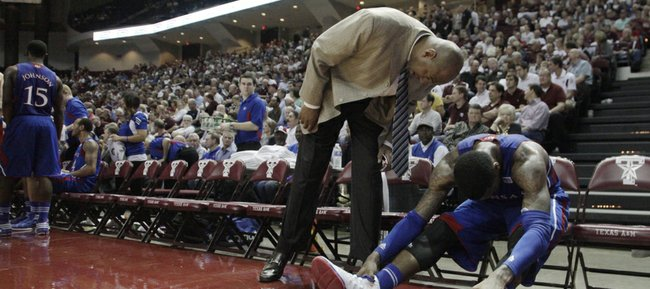 Assistant coach Danny Manning talks to a frustrated Thomas Robinson during a timeout in the second half of the Jayhawks 66-58 win over the Aggies Wednesday, February 22, 2012,  in College Station, TX.